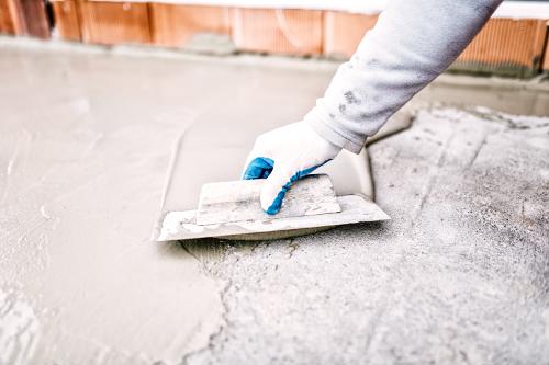 Worker Spreading Concrete